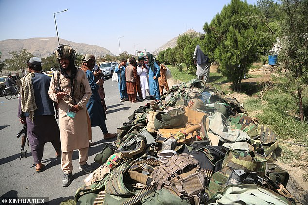 McMaster's scathing assessment came as the Taliban took complete control of Kabul. Above, Taliban fighters stand beside the belongings of Afghan security soldiers in Kabul on Monday