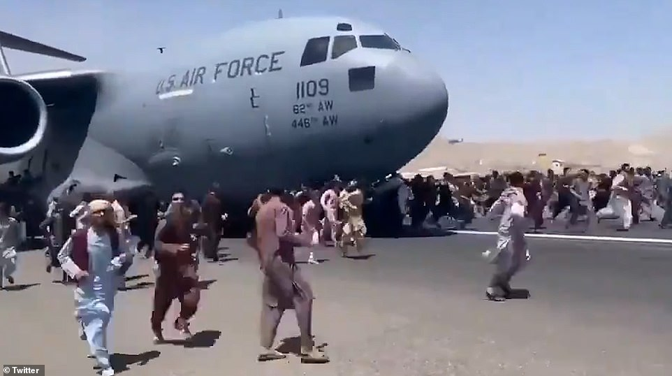 Desperate Afghan nationals tried to run onto RCH885 as it took off from the airfield on Monday. Some were crushed by the C-17's wheels and others clung to the fuselage as it took off