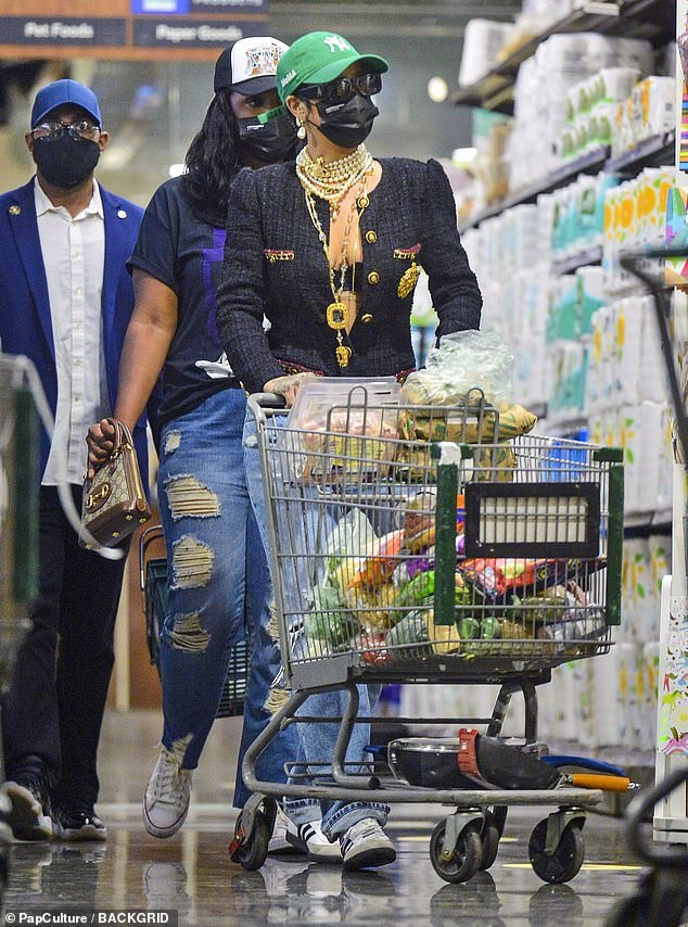 Not too posh to push:Rihanna, 33, has proven that despite her billionaire status, she's not afraid to push her own trolley, as she headed to her local Whole Foods in Manhattan on Sunday