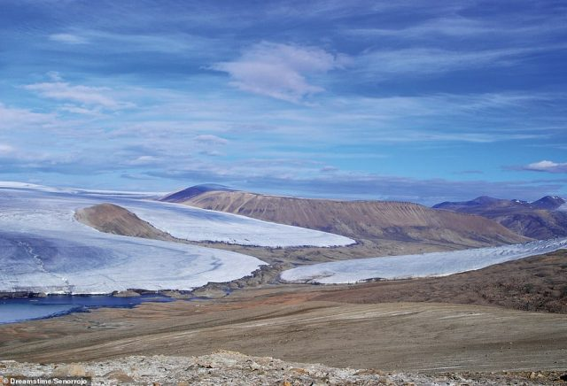 """ELLESMERE ISLAND, NUNAVUT, CANADA: According to the author, in Quttinirpaaq National Park, the Charybdis glacier almost touches noses with Scylla glacier (centre), 'the pair named after the sea monsters of Greek myth'. Martin writes: 'In Inuktitut, Quttinirpaaq means """"top of the world"""", a suitable name for the world¿s second-most northerly national park, after the Northeast Greenland National Park'"""