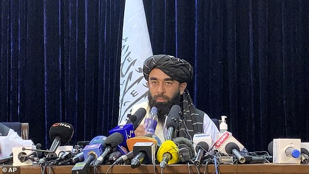 Pictured: Zabihullah Mujahid, chief spokesman for the Taliban, speaks during a press conferenc in Kabul on Tuesday, August 17, 2021.For years, Mujahid had been a shadowy figure issuing statements on behalf of the militants