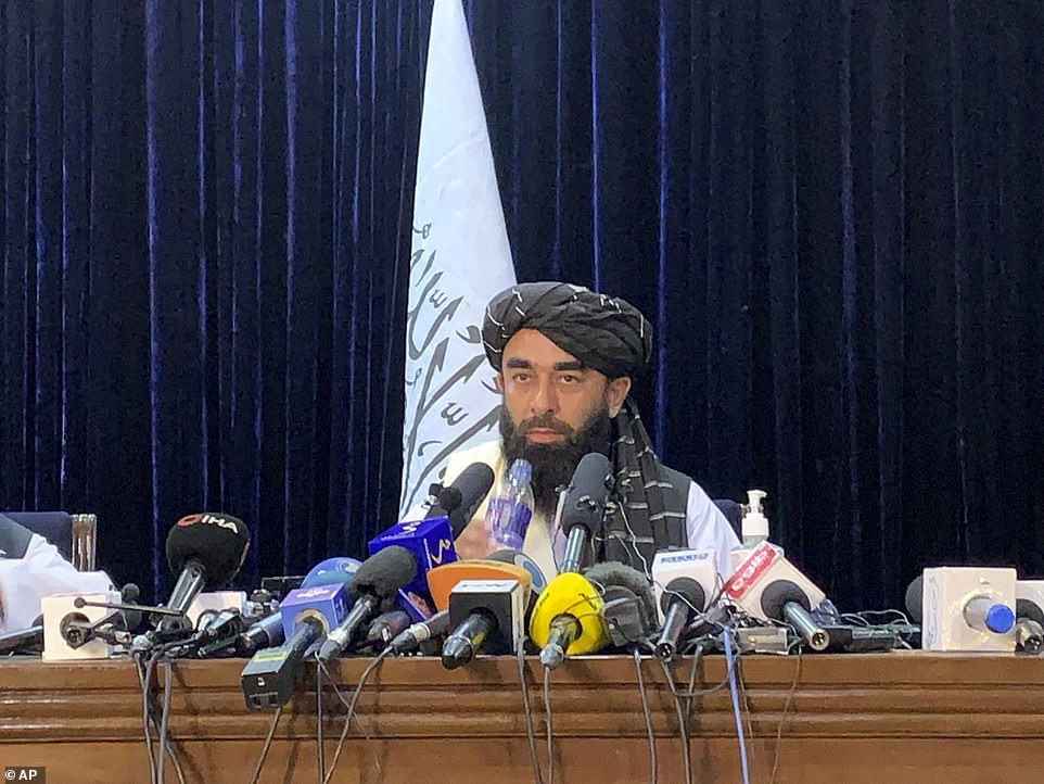Taliban spokesman Zabihullah Mujahid speaks at at his first news conference in Kabul, Afghanistan. The group said they 'want to live peacefully' after taking control of Afghanistan in a lighting conquest in little over a week, leading to human rights concerns in the country. 'There is a huge difference between us and the Taliban of 20 years ago, this has been an evolutionary process for us'