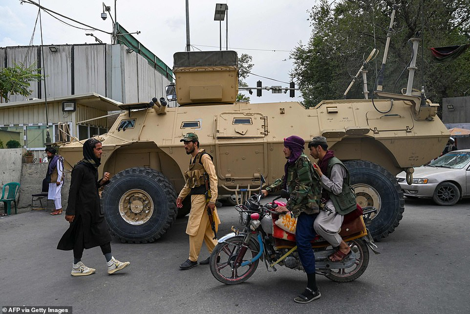 Taliban fighters patrol along a street in Kabul on August 17, 2021, as the Taliban moved to quickly restart the Afghan capital following their stunning takeover