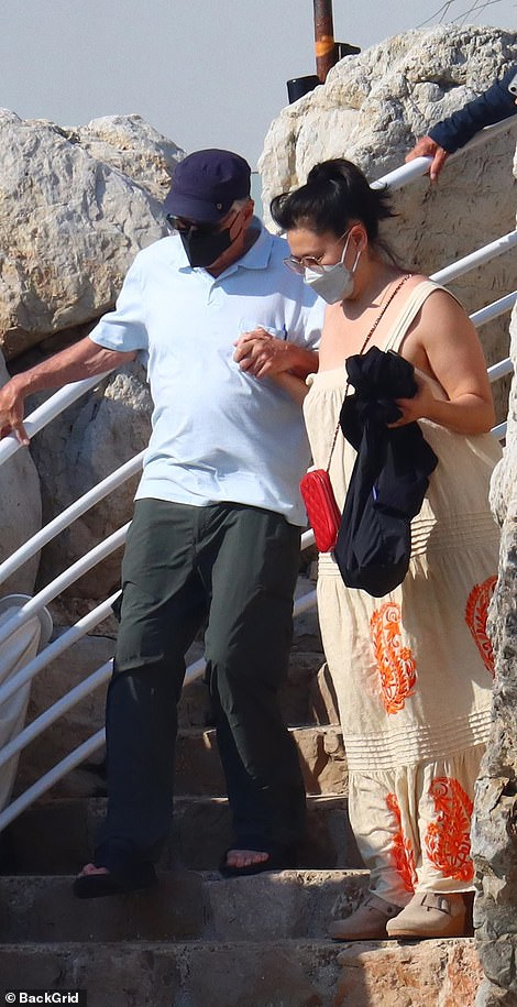 I've got you: The mystery lady proved to be a great support to Robert as they made their way down the stone steps