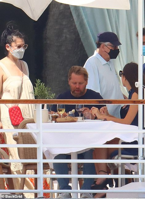 Is that him: The Hollywood star turned heads as he walked past other diners