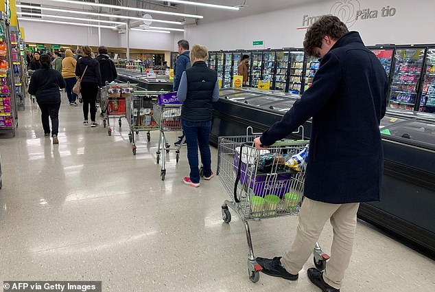 Shoppers at a supermarket in Wellington (pictured) soon after the lockdown was announced