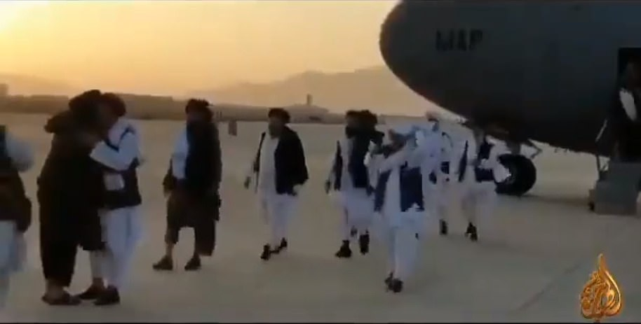 Around a dozen people joined Baradar on the flight and were noisily welcomed on the runway