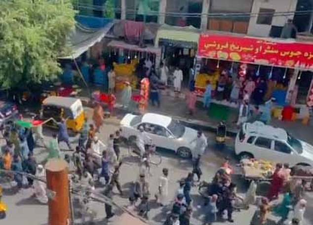 Pictured: Protesters marched through the cities of Jalalabad and Khost on Wednesday, which sit around 80 miles from the Afghan capital of Kabul. Pictured: Scenes from Jalalabad