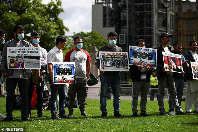 """Demonstrators take part in a """"Save Afghanistan"""" protest in Parliament Square today"""