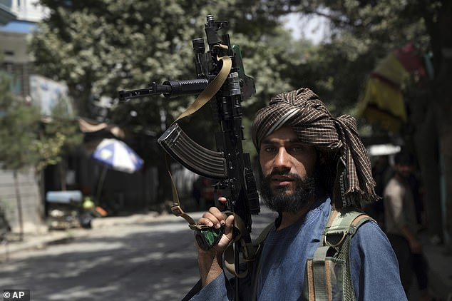 The Taliban has insisted there will be total amnesty for those who fought against them in Afghanistan and that evacuation flights will be protected, but there have been reports of gunmen firing into crowds (pictured, a fighter in Kabul on Wednesday)