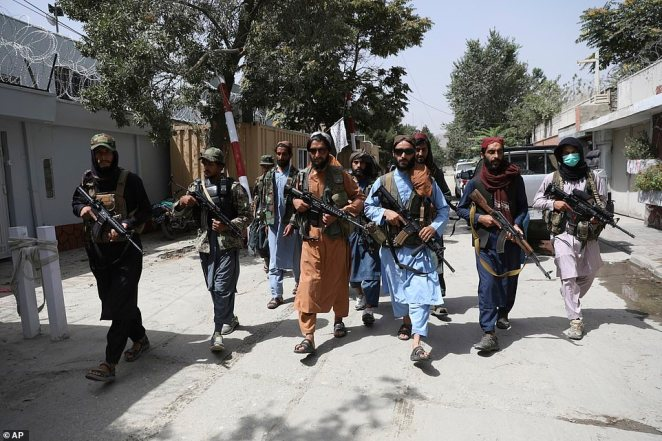 Taliban fighters patrol in the Wazir Akbar Khan neighborhood in the city of Kabul, Afghanistan, Wednesday, Aug. 18, 2021. The group is becoming increasingly violent, abandoning promises to be peaceful, and their cooperation is what the evacuation mission is relying on