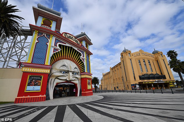 Anyone in the suburbs of Bayside, Glen Eira or Port Phillips especially were asked to get tested if they show even the slightest symptoms (pictured, a quiet Luna Park at St Kilda on Wednesday)