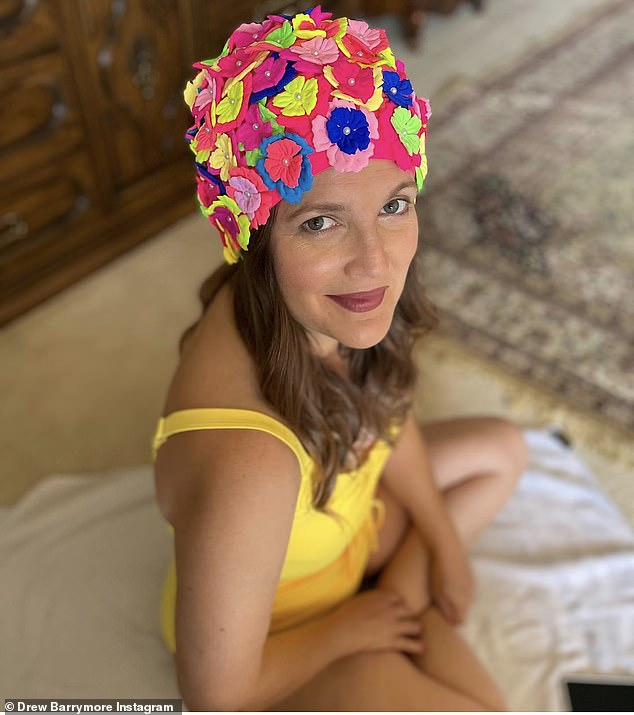 Dressed for the beach: Drew Barrymore wore a yellow swimsuit and bathing cap decorated with flowers in his latest Instagram post