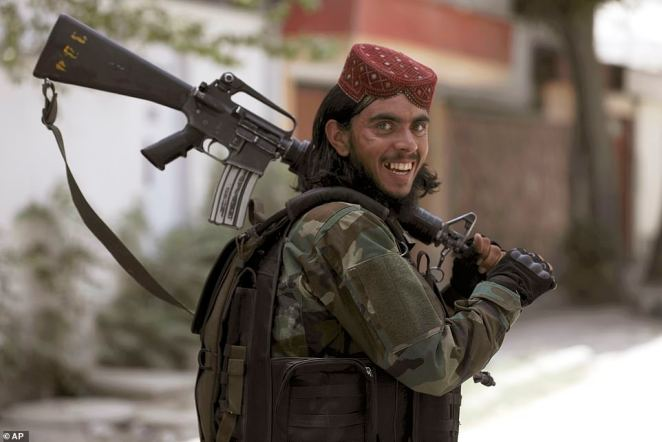 A Taliban fighter patrols in Wazir Akbar Khan in the city of Kabul in Afghanistan on Wednesday