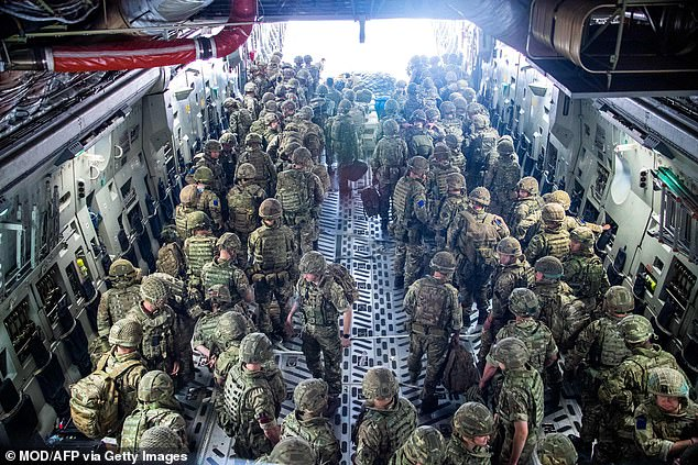 Members of the British Army, from 16 Air Assault Brigade, disembark from an RAF Voyager aircraft after landing in Kabul on Tuesday. Britain now has 900 troops in Afghanistan