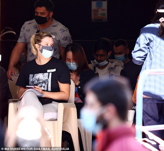 Masked Sydneysiders are pictured in Bankstown in the city's south-west on Wednesday