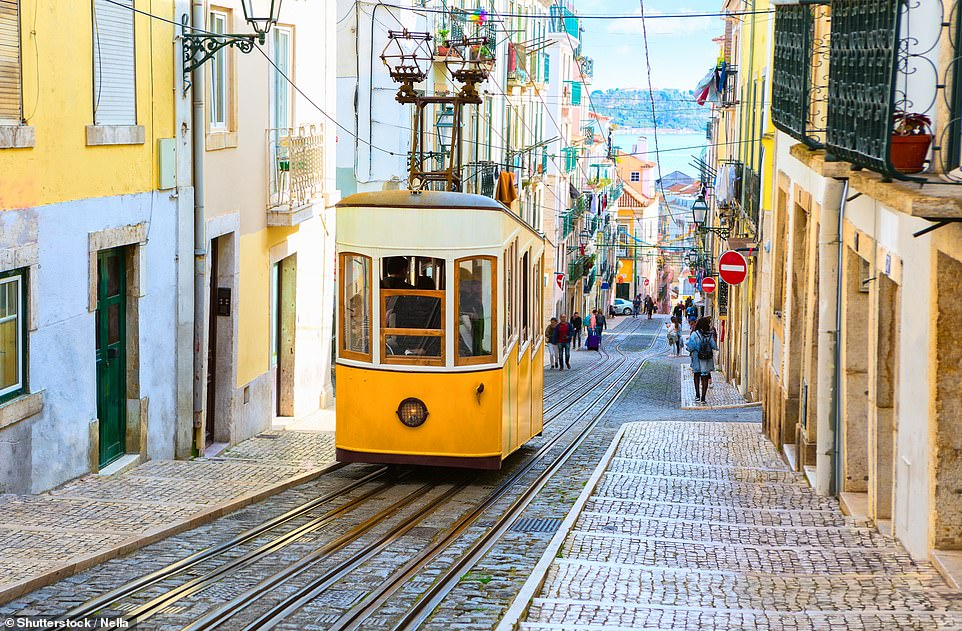 Lisbon, as well as being a haven for art-lovers, is one of the world's oldest cities. Pictured is the city's Bica tram