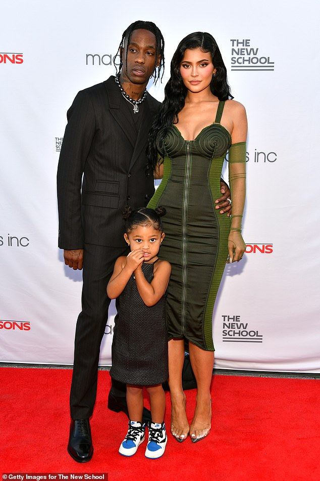 Growing family: Kylie Jenner and on/off beau Travis Scott had reportedly been trying for baby number two for 'over a year' before their pregnancy news emerged last week. They're seen with daughter Stormi in June above