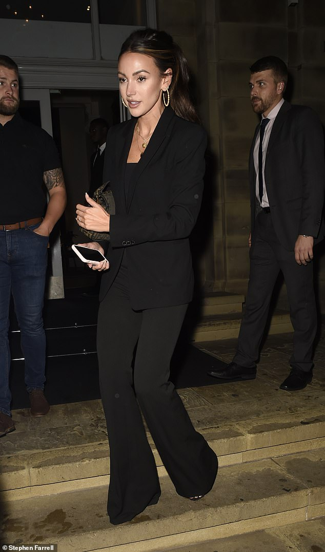 Fashion maven: The actress, 34, looked stylish as ever as she stepped out in a black blazer and trouser suit which she accessorised with a Fendi handbag