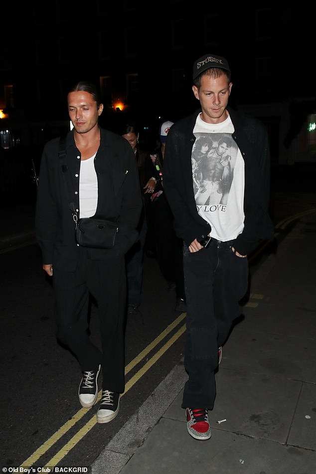 Dinner: Joining the girls was Marc, 33, (right) who dressed casually in a white T-shirt and dark jeans as he headed into the popular eatery with the group
