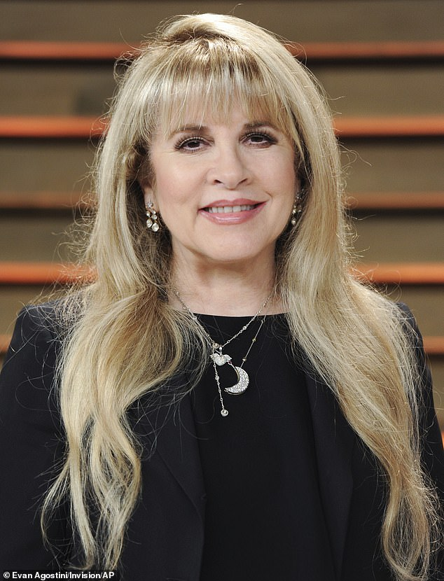 Walk down memory lane: Stevie Nicks, 73, revealed she's considering sharing her life story in a memoir and biopic during a conversation with singer Tim McGraw on his Apple Music Country show - Beyond The Influence Radio; Nicks seen in 2014