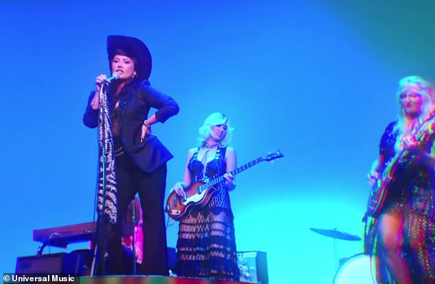 Rock n roll:The Grammy nominee was also seen on stage singing with a band, rocking a giant black Stetson hat and a black blazer