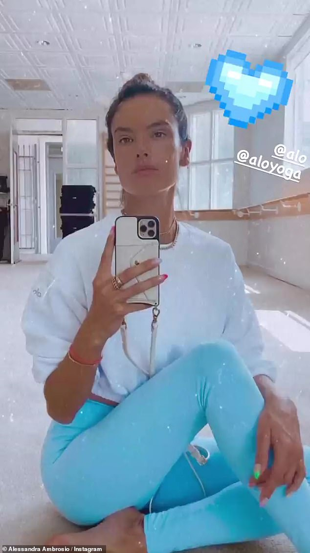 Promo mode: The longtime supermodel also slipped advertising mode by posing in Alo Yoga gear, while testing out her new filter