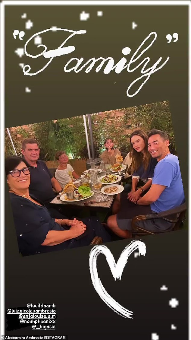 Quality time: The mother of two shared a family moment on Instagram on Thursday with a photo of herself holding hands with boyfriend Richard Lee, seemingly out at a restaurant, alongside her daughter Anja, 12, son Noah, nine, and her parents, Lucilda and Luiz Ambrosio