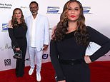 Tina Knowles rocks sleek off-the-shoulder jumpsuit as she poses with Richard Lawson at charity gala