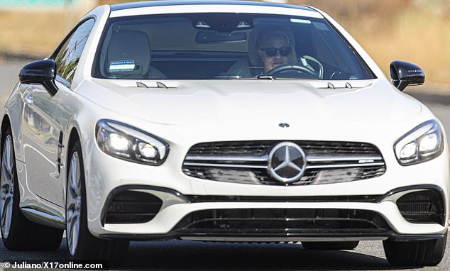 Out and about:Britney Spears was spotted taking her gleaming white Mercedes out for a spin in Los Angeles this Friday