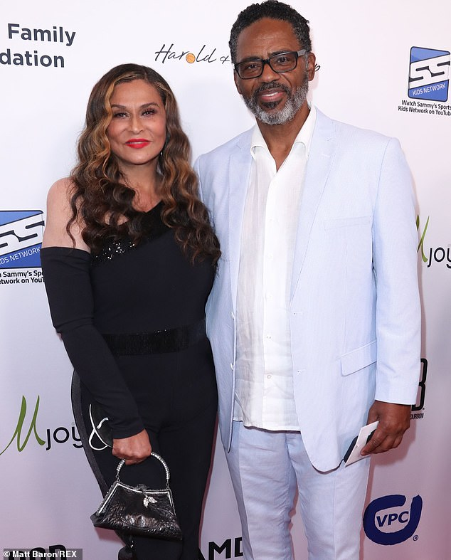 Swanking about:Richard, whose first wife was Berry Gordy's niece Denise, cut a summery figure in a pale blue suit over a white shirt he left untucked