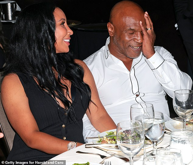 Audience:Mike Tyson was spotted at one of the tables modeling a white ensemble whilst sat alongside his third wife Lakiha Spicer