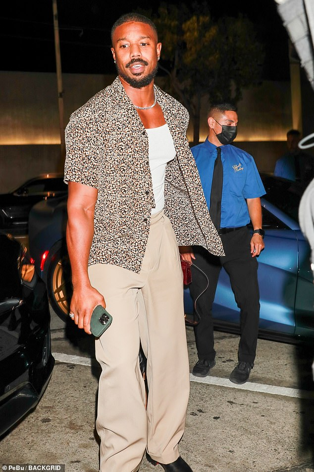 Handsome as ever:The actor looked as handsome as ever as he modelled a stone co-ord which featured a patterned open shirt and matching beige slacks