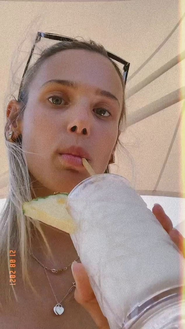 Beauty:She then followed up the post with a selfie in which she was sipping on a piña colada. Marloes (pictured) appeared to be barefaced in the image, donning only a pair of shades