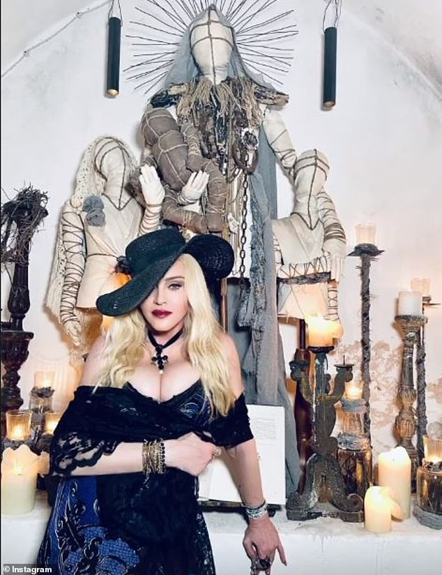 Wow: Madonna still seemed in high spirits on Friday from celebrating her 63 birthday earlier this week as she oozed glamour in a very busty dress while visiting a church in Ostuni, Italy