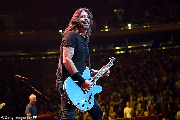 Not interested: Foo Fighters frontman Dave Grohl recently told The Sun that he had no interest in being seen as a source of political inspiration; he is seen performing in June