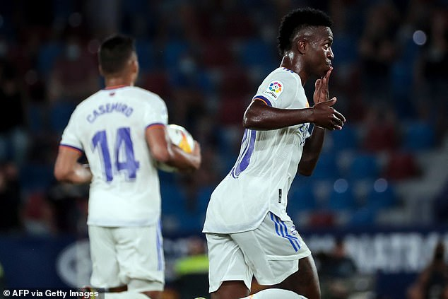 The striker celebrates after scoring his second goal to rescue a point for Madrid at Levante