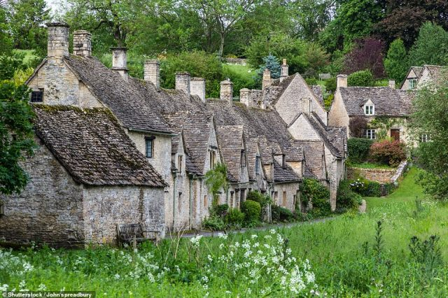 William Morris once described Bibury as¿the most beautiful village in England¿. Pictured are the village'sArlington Row cottages, which Lizzie and her group stroll past. She writes: 'A National Trust notice politely reminds us that these are homes and we try not to be too obvious as we photograph them'