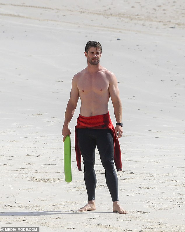 Life's a beach: Last Tuesday, Chris Hemsworth showed off his washboard abs as he and wife Elsa Pataky hit the beach in Byron for a surf