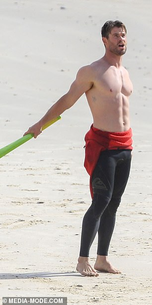 Thor blimey! He looked relaxed as he got some sun by peeling off the top half of his wet suit to reveal his muscular physique