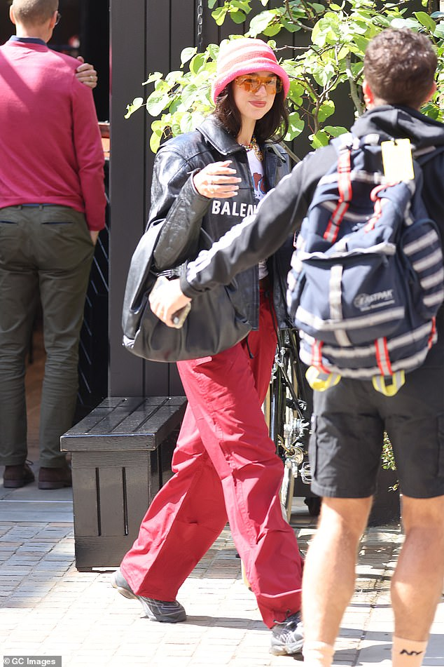 All smiles: Dua looked pleased as she strutted along in the sunshine