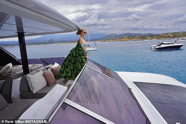 Idyllic:Paris has been enjoying her break in the mountainous Mediterranean island alongside fiancé Carter Reum