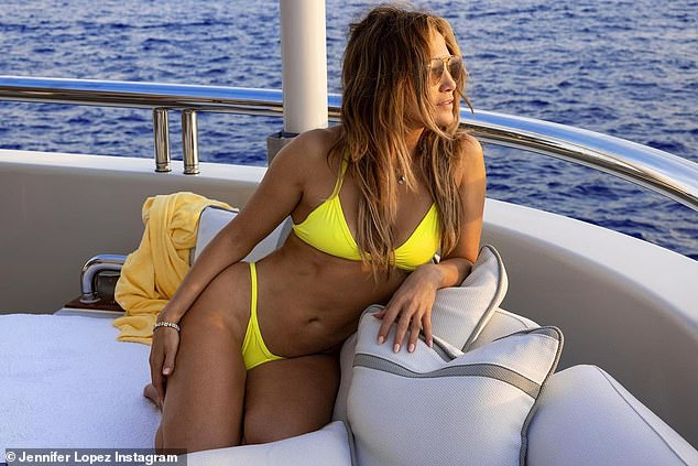 Lopez is lovely: She posed in a bright yellow bikini while on a yacht in Europe this summer