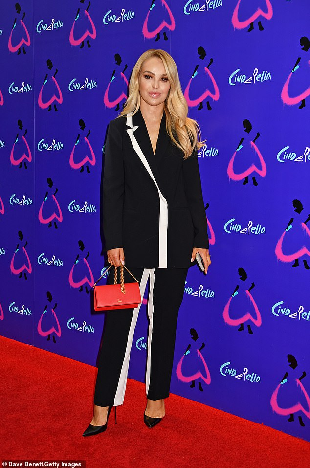 Sensational:Katie Piper cut an elegant figure in a black blazer and matching trousers with a white stripe detail