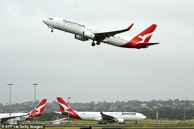 Qantas is on track to restart international flights from the end of 2021, the airline announced on Thursday morning. Pictured a Qantas plane at Sydney International Airport on August 3