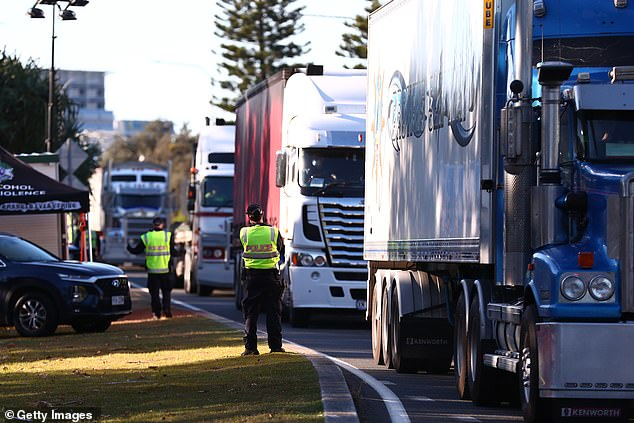 Queensland Police stop trucks at the Queensland border - every vehicle is being checked under current border restrictions