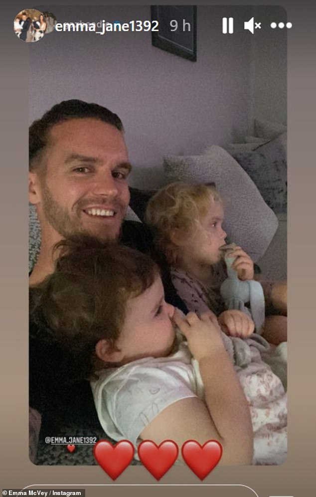 Heartwarming: Emma also shared a snap of Gary cuddling their children Chester, three, and Primrose,18 months