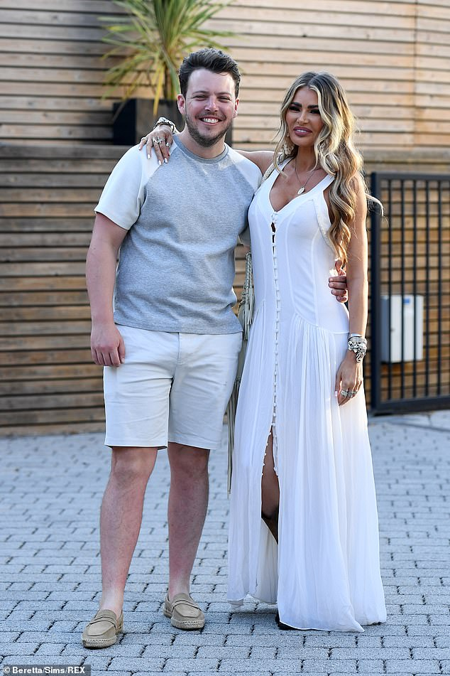 Pals: Chloe beamed as she cosied up to James Bennewith who kept things casual in a grey T-shirt and white chino shorts