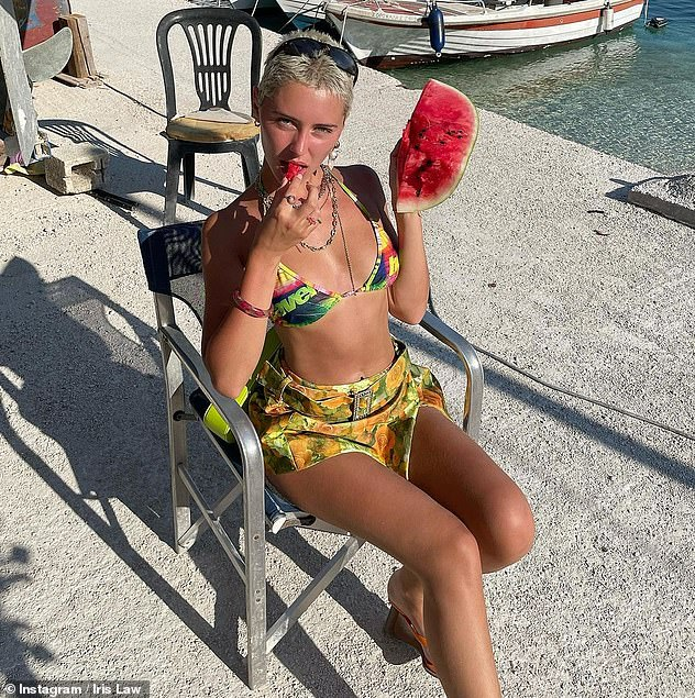 I carried a watermelon:Earlier in the week, Iris showcased her incredible figure in a colourful tie-dye bikini as she hit the beach with her pals in a series of Instagram snaps