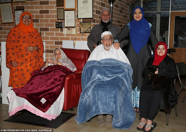 The Ahmad family at Bonyrigg has closed its doors to the usual Sunday family gatherings of up to 40 people in order to protect the health of grandmother Jamal Ara Ahmad, 89 (pictured second from left) and Qazi Ashfaq Ahmad, 91 (front, centre). Also pictured ( from left) are: Mehar Ahmad, 65; Zia Ahmad, 68; Mohinbah Ahmad, 32; and Rubinah Ahmad, 30